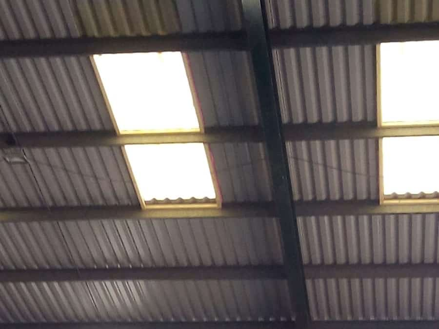 workshop roof and skylights spray foam insulation close up before