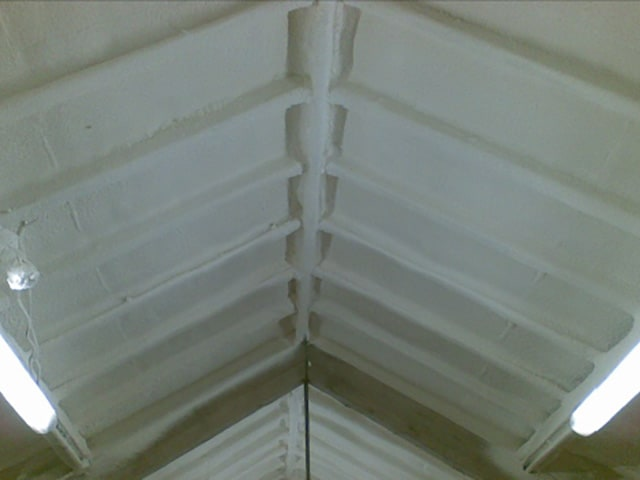 Spray foam insulation on workshop